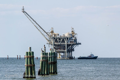 Gas well and crew boat. Taken from the Mobile Bay ferry property near Fort Morgan.