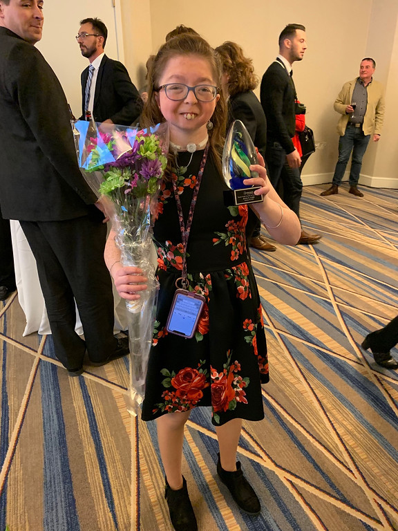 . Honoree Julia Cobb of Northboro proudly show her award and flowers she received.