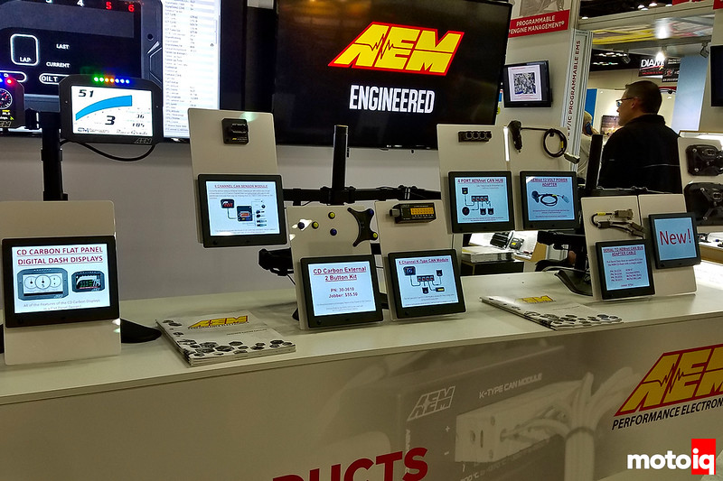 A display of many new AEM electronics components on monitor arms