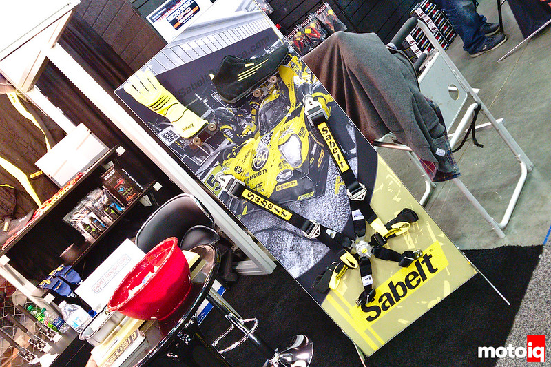 Vertical Sabelt display with glove, shoe and 6-point harness