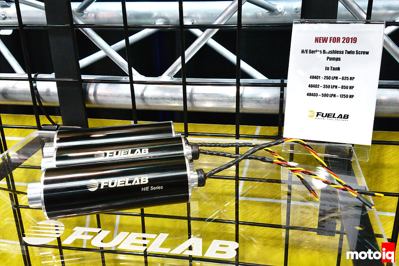 3 Fuelab brushless twin screw H/E series fuel pumps on a glass shelf