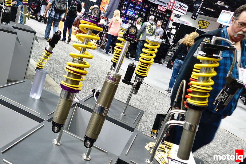 KW circle track coilovers on a display stand
