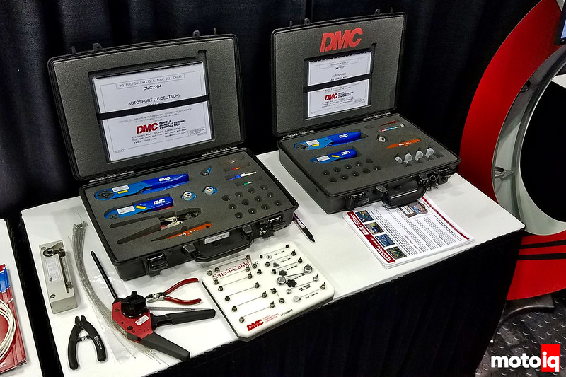 DMC wiring kits with hard cases and DMC Safe-T-Cable solution on a table