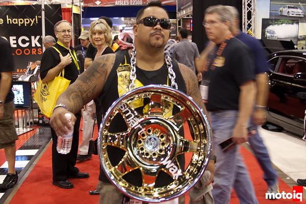 Guy with wheel at SEMA show