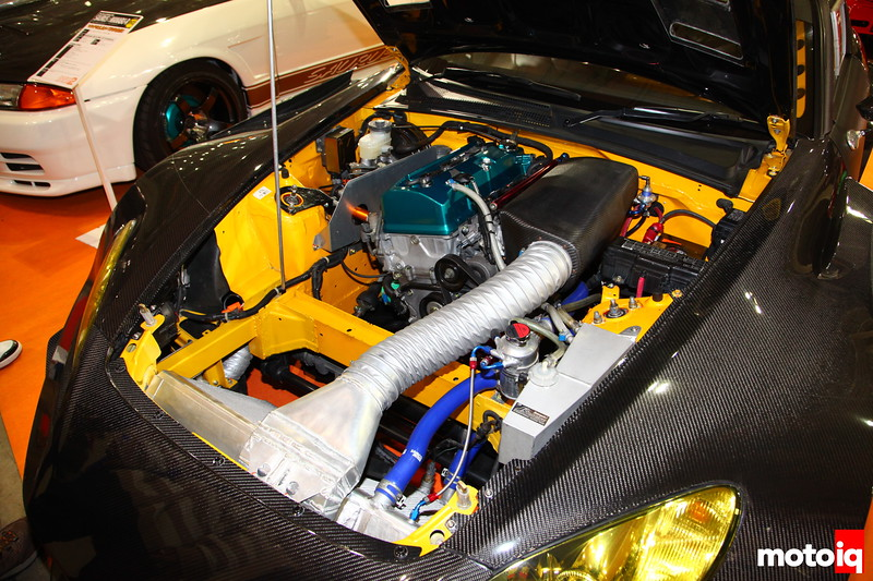 J's Racing built this 2.4L S2000 w/a B2 Toda Camshaft, ported heads, quad throttle body encased in carbon.