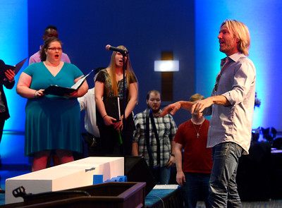 Grammy award winning composer and conductor Eric Whitacre works with the UWF Singers before the University of West Florida's 50th Anniversary Gala Wednesday, November 16, 2016 at the Hilton Pensacola Beach. The UWF Singers with Whitacre conducting, performed two selections during the gala.