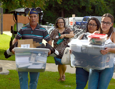 Students move their belongings into Martin Hall with the help of parents and volunteers  Friday, August 19, 2016 during Move-In Day at the University of West Florida.