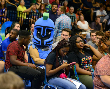 Argie sits with students during the New Student Convocation Friday, August 19, 2016 at the UWF Field House.