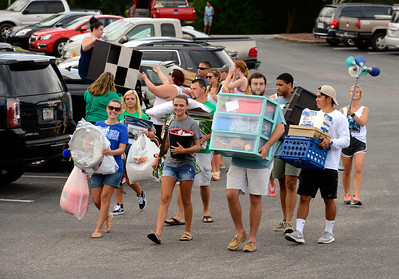 Students move their belongings into Martin Hall with the help of parents and volunteers  Friday, August 19, 2016 during Move in Day at the University of West Florida.