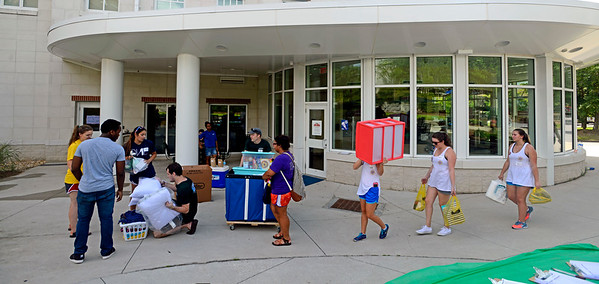 Students move their belongings into Presidents Hall with the help of parents and volunteers Friday, August 19, 2016 during Move in Day at the University of West Florida.