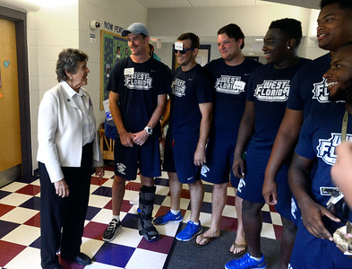 University of West Florida President Dr. Judy Bense chats with UWF Football players at Argo Hall Friday, August 19, 2016 during Move-In Day at the University of West Florida.