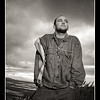 Kosha-Dillz-Featured_MG_3688-dramatic-sky-stormy-clouds-hip-hop-portrait