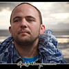Kosha-Dillz-Featured_MG_3892-dramatic-sky-stormy-clouds-hip-hop-portrait