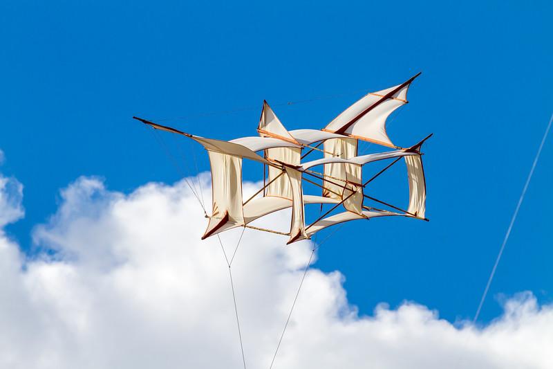 Kite on a blue sky and white clouds. International Kite Festival, Scheveningen.