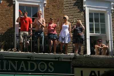 Notting Hill Carnival revellers on windowsills!