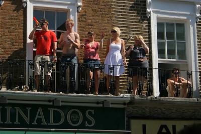 Notting Hill Carnival revellers on windowsills!