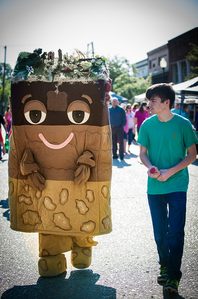 """Sam E. Soil"" is portrayed by Jacob Ackerman (left) is assisted by Tanner McMillan (right) in offering educational information for the DeSoto County Soil and Water Conservation District as part of the DeSoto County Earth Day Celebration on Saturday, April 23, 2016 in Hernando."