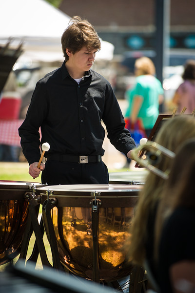 Sean Gage plays the tampani drums during a performance of the Lewisburg High School Symphonic Band during the Earth Day Celebration on the courthouse lawn in Hernando on Saturday, April 23, 2016.