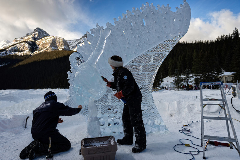 "Ice Magic Festival 2014,Hosted by The Fairmont Chateau Lake Louise, this 34 hour competition is the most anticipated spectacle of the Festival. This year's ice carvers are hand picked, by invitational only, as some of the best and loyal carvers from the last 20 years that we've had the pleasure to watch create and execute ice masterpieces. Watch in amazement as Internationally renowned professional ice carvers work to sculpt towering one-of-a-kind works of art from imposing blocks of solid ice on the shores of Lake Louise.  With each ice block weighing a daunting 300lbs, this exceptional art form involves grueling physical labour in a delicate balancing act with precision artistry.   In celebration of the Sochi 2014 Winter Olympics we're going to Freeze Olympic Fever! Carvers will celebrate Ice Magic, the ""Olympics of ice carving"", by capturing the Olympic spirit in ice."