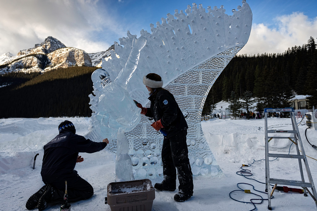 """Ice Magic Festival 2014,Hosted by The Fairmont Chateau Lake Louise, this 34 hour competition is the most anticipated spectacle of the Festival. This year's ice carvers are hand picked, by invitational only, as some of the best and loyal carvers from the last 20 years that we've had the pleasure to watch create and execute ice masterpieces. Watch in amazement as Internationally renowned professional ice carvers work to sculpt towering one-of-a-kind works of art from imposing blocks of solid ice on the shores of Lake Louise.  With each ice block weighing a daunting 300lbs, this exceptional art form involves grueling physical labour in a delicate balancing act with precision artistry.   In celebration of the Sochi 2014 Winter Olympics we're going to Freeze Olympic Fever! Carvers will celebrate Ice Magic, the """"Olympics of ice carving"""", by capturing the Olympic spirit in ice."""