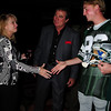 """Vince Papale and Matt Collier, who is wearing the Mark Wahlberg """"costume"""" from the movie Invincible which is about Vince Papale's life greeting Janet Papale."""