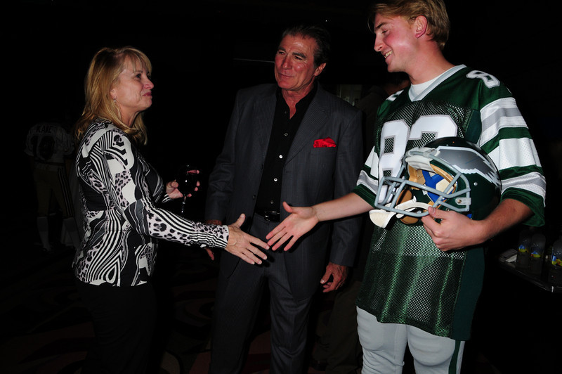 "Vince Papale and Matt Collier, who is wearing the Mark Wahlberg ""costume"" from the movie Invincible which is about Vince Papale's life greeting Janet Papale."