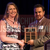 Laura Bernstorf is prestented the Pat Ayars Mentoring Award by Oxford Senior living's Jason Wiley