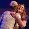 Tammy Taylor-Lindholm, Meritrust Credit Union, hugs 40 Under 40 honoree Angela Clark, Envision Inc., Wednesday night at the 2016 40 Under 40 honors program.