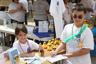 The third annual Duck Derby fundraiser for Adopt-A-Family of the Palm Beaches at CityPlace on Saturday, March 8, 2015 in West Palm Beach.  (L to R) Maya Laing and Harry Laing