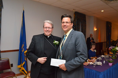 Edward Razz presenting the Reverend Daniel D. Hogan Council gift to the Bishop.