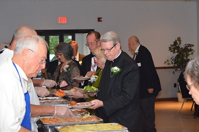 Bishop Edward B. Scharfenberger at the buffet line.