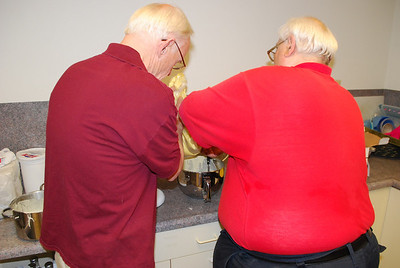 Robert and Mike putting some eggs in the batter.