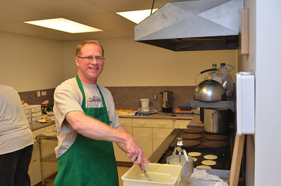 John our pancake chief is making ready some more batter.