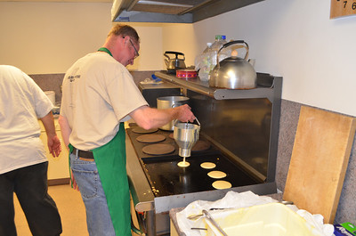 A new batch of IHOP pancakes being made.