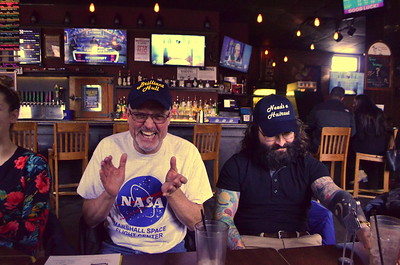 """Laurence Graduated from the University of Hull.   The school colors are Blue and yellow.   In order to cover that brilliant skull - we got him the Brilliant Hull Cap.    Kyle got """"Needs a Haircut"""" hat."""