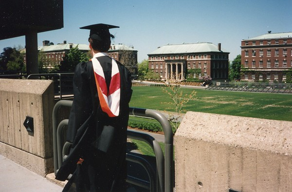RPI graduate picture of the back of Mark's head and robe.