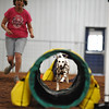 Cheryl Bullard, left, guides her dog Preslee through the tunnelers course during the NADAC Agility Trial, Friday, April 15, 2016, at the Cleveland County Fairgrounds.  The trails continue today at 8 a.m. and is open and free to the public.  (Kyle Phillips / The Transcript)
