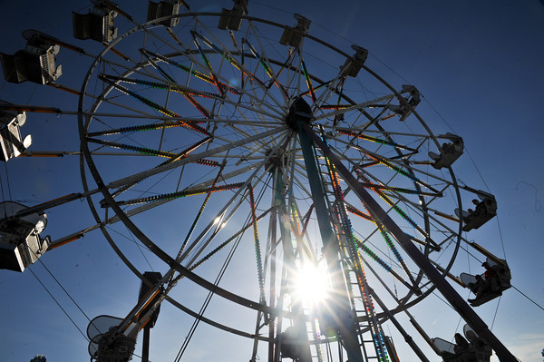 Fairgoers ride the Farris Wheel, Saturday, April 23, 2016, during the Lions Club Carnival. (Kyle Phillips / The Transcript)