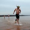 Triathletes plunge into Lake Thunderbird