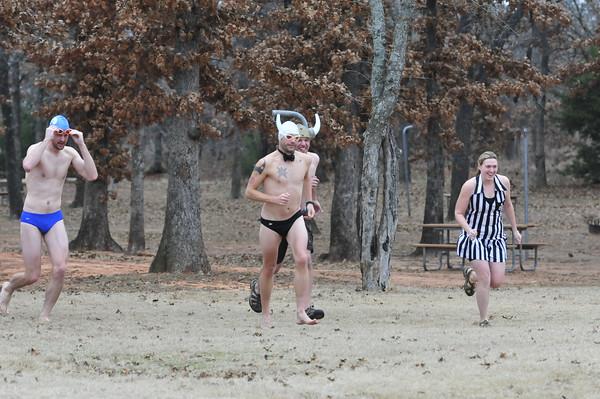 Members of the Oklahoma City Triathlon Club plunge into Lake Thunderbird to celebrate the New Year