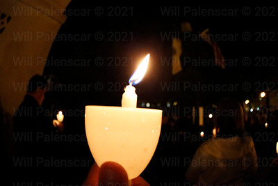 A candle is held during the Candlelight vigil ceremony during Police Week 2015