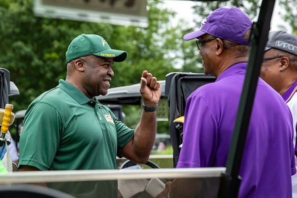 Gregory Washington visits with participants before the 25th Annual Diversity Scholarship Golf Classic. Photo by: Shelby Burgess/Strategic Communications/George Mason University, Gregory Washington