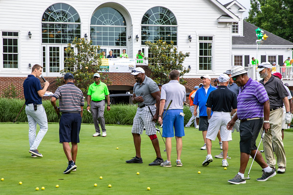 Participants practice putting before the 25th Annual Diversity Scholarship Golf Classic. Photo by: Shelby Burgess/Strategic Communications/George Mason University
