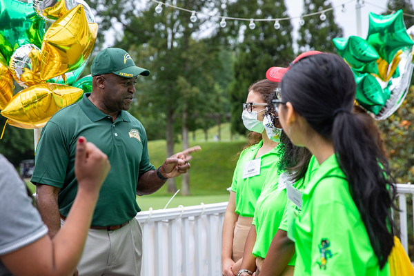 Gregory Washington visits with students during the 25th Annual Diversity Scholarship Golf Classic. Photo by: Shelby Burgess/Strategic Communications/George Mason University, Gregory Washington