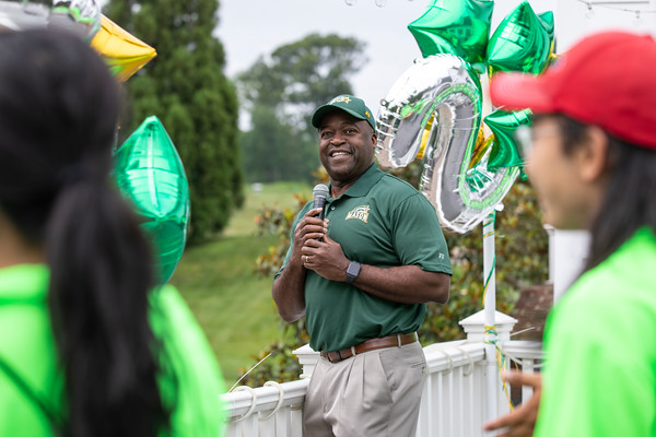 Gregory Washington gives opening remarks at the 25th Annual Diversity Scholarship Golf Classic. Photo by: Shelby Burgess/Strategic Communications/George Mason University, Gregory Washington