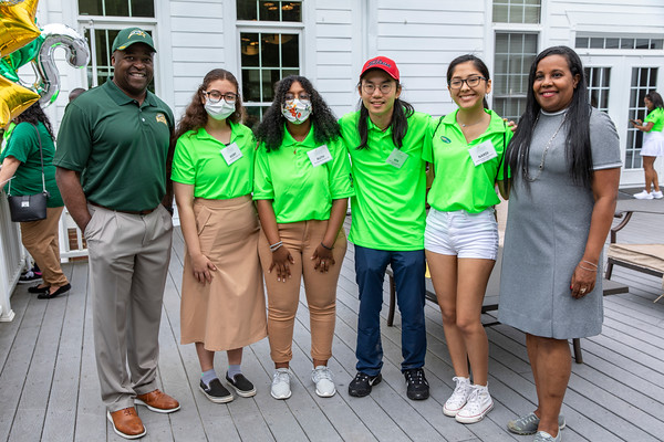 Gregory Washington and Charniele Herring visit with students at the 25th Annual Diversity Scholarship Golf Classic. Photo by: Shelby Burgess/Strategic Communications/George Mason University, Gregory Washington