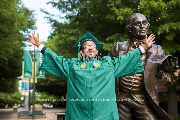 Happy graduate.  Photo by:  Ron Aira/Creative Services/George Mason University