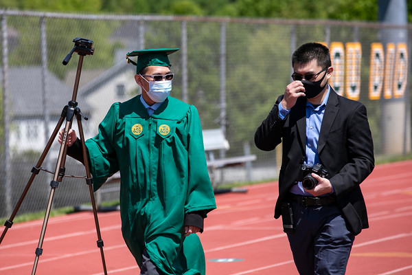 Graduates attend the Patriot Procession with friends and family for photo opportunities at  the soccer stadium. Photo by: Shelby Burgess/Strategic Communications/George Mason University