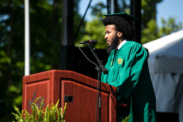 Student Speaker Devin Stewart speaks during the 2021 College of Humanities and Social Sciences I Mini Ceremony.   Photo by:  Ron Aira/Creative Services/George Mason University