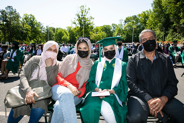 Graduates attend the 2021 College of Humanities and Social Sciences Mini Ceremony.  Photo by:  Ron Aira/Creative Services/George Mason University